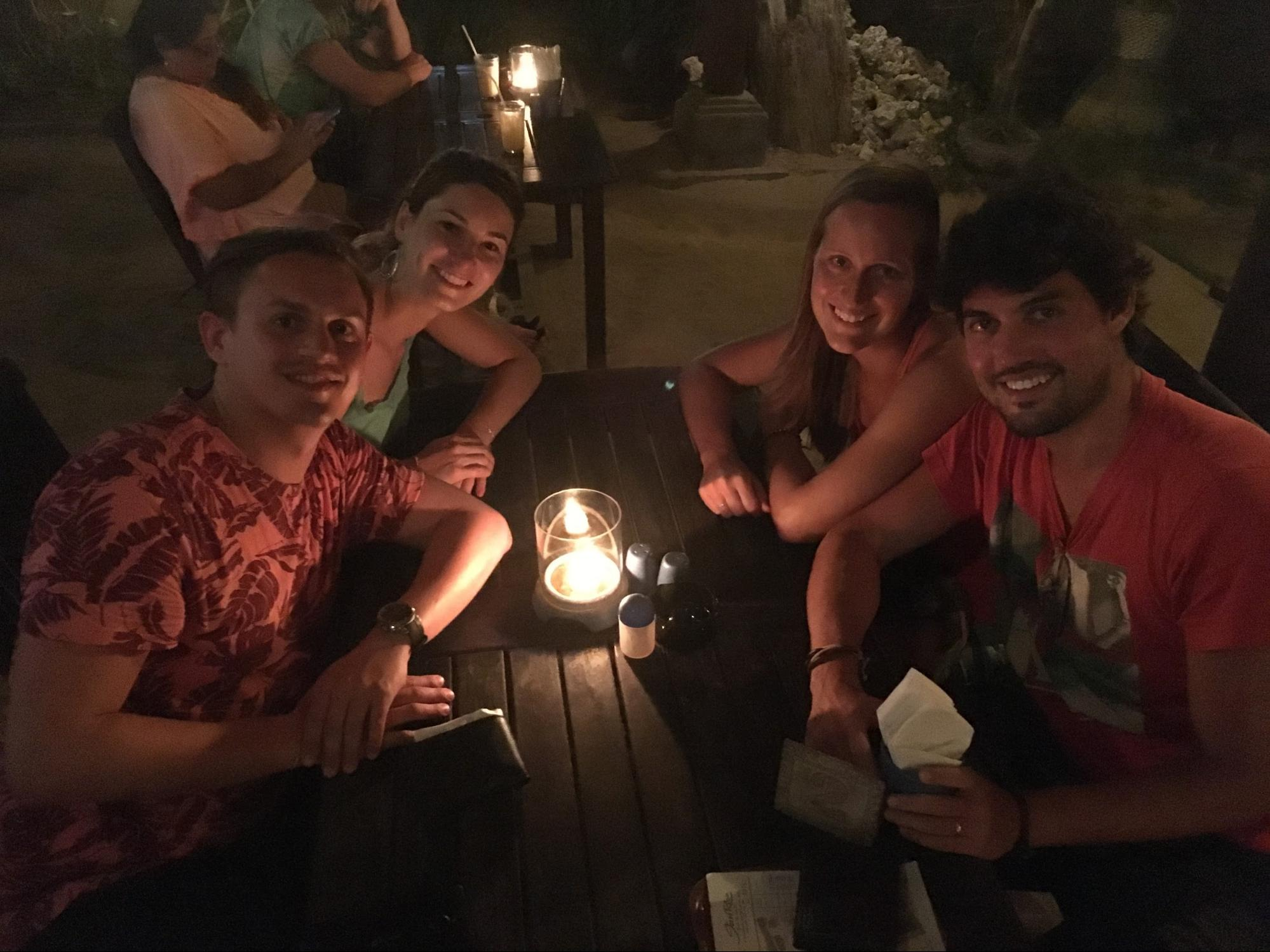 Aurelia from Medtronic and her partner (left) sharing dinner and drinks in Bali with my wife and me